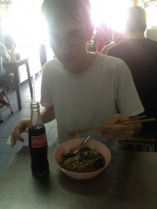 Eating duck noodle soup in a roadside restaurant, Bangkok